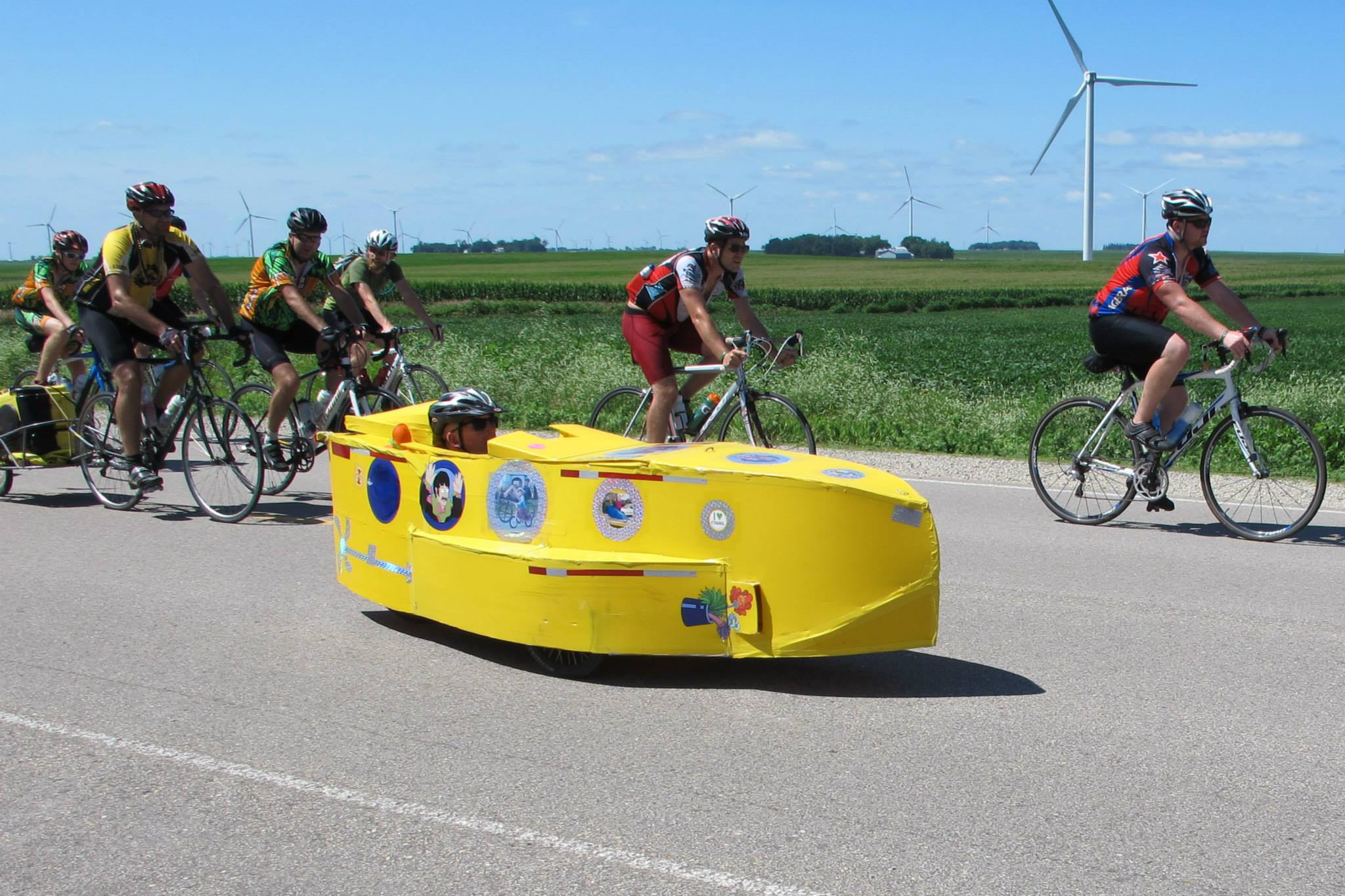 Yes, that is a pedal-powered Yellow Submarine with onboard speakers playing Beatles' hits.