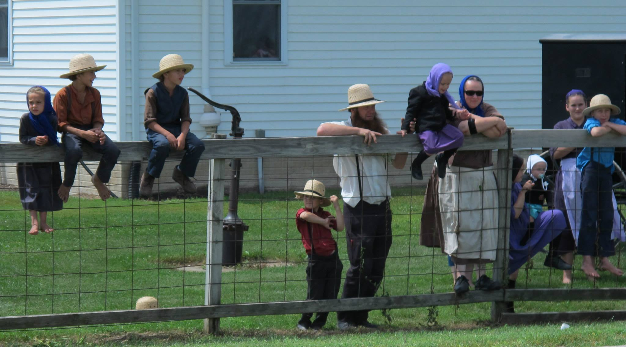Amish at a country school observe RAGBRAI passing by.