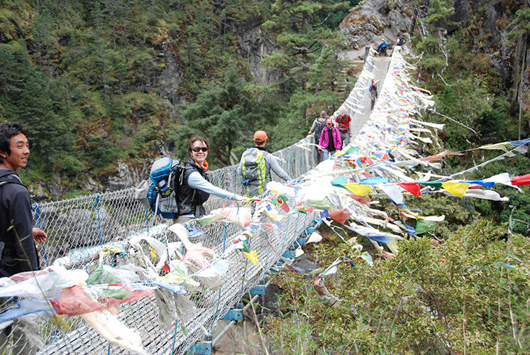 Imja Khola suspension bridge with prayer flags