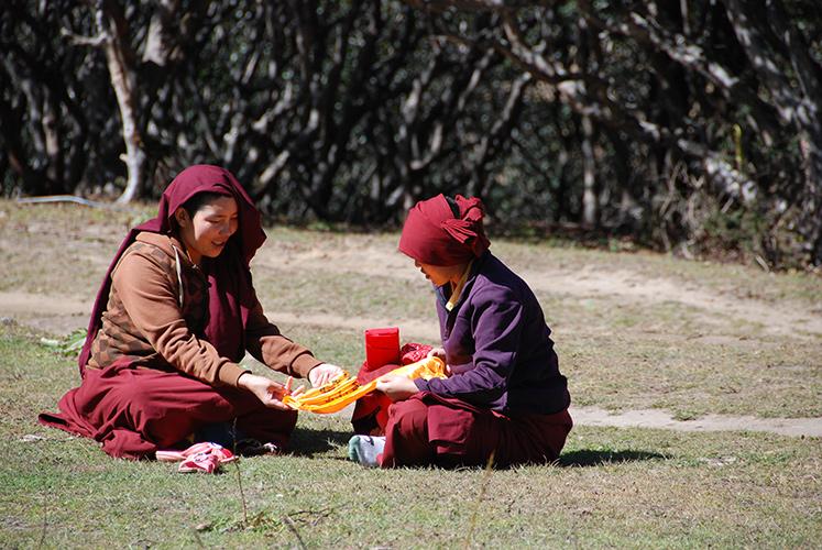 Buddhist nuns folding cloth