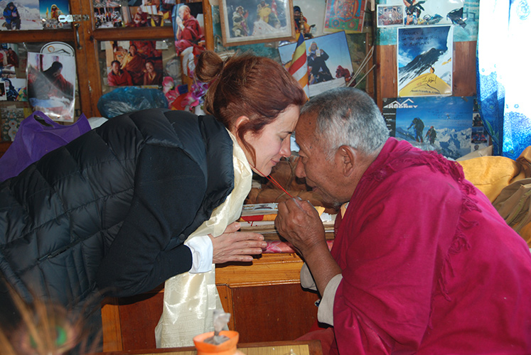 Lama Geshe offers a blessing at Pangboche to an Everest trekker