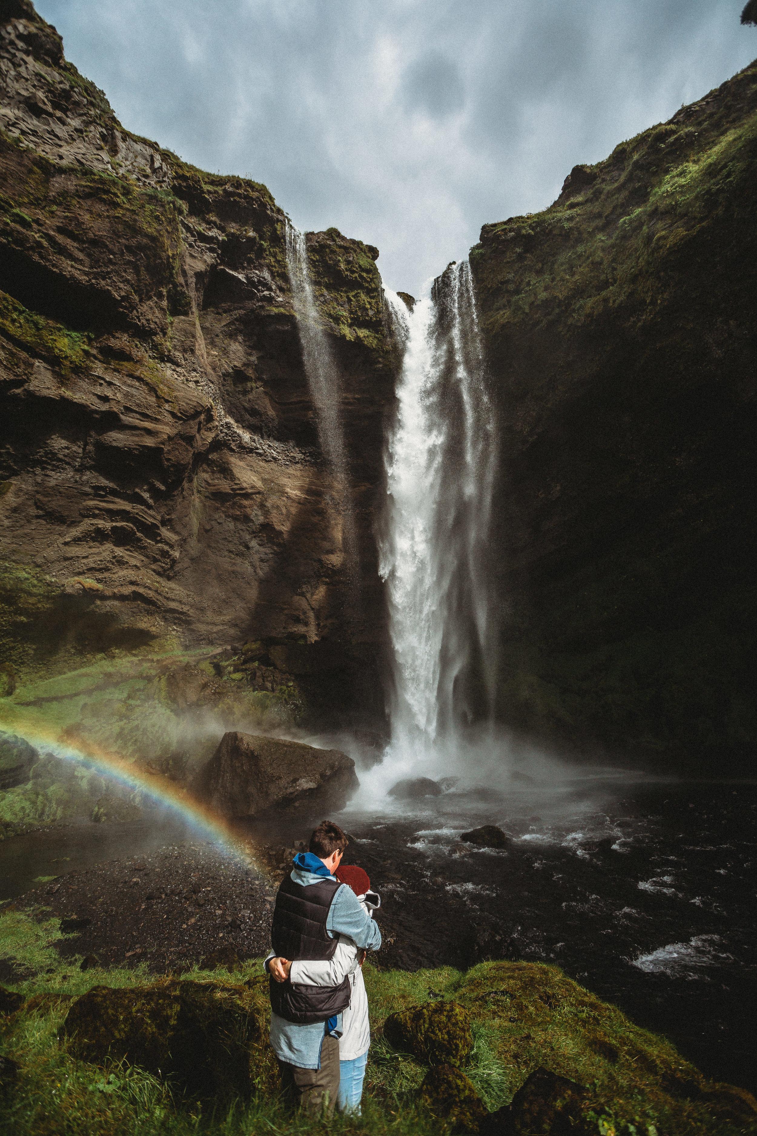 iceland adventure engagement photos secret waterfall rainbow