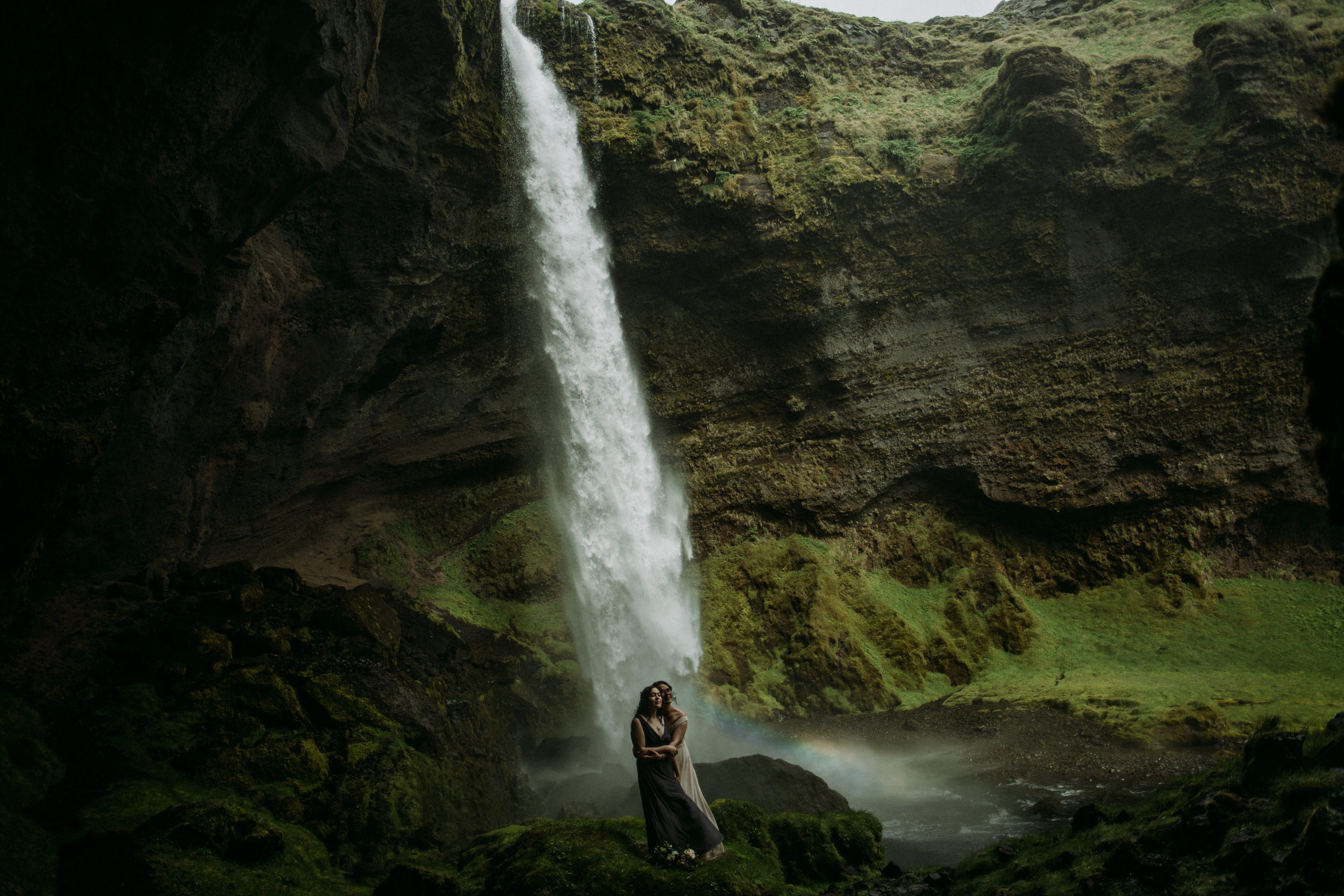 lgbtq iceland elopement at waterfall