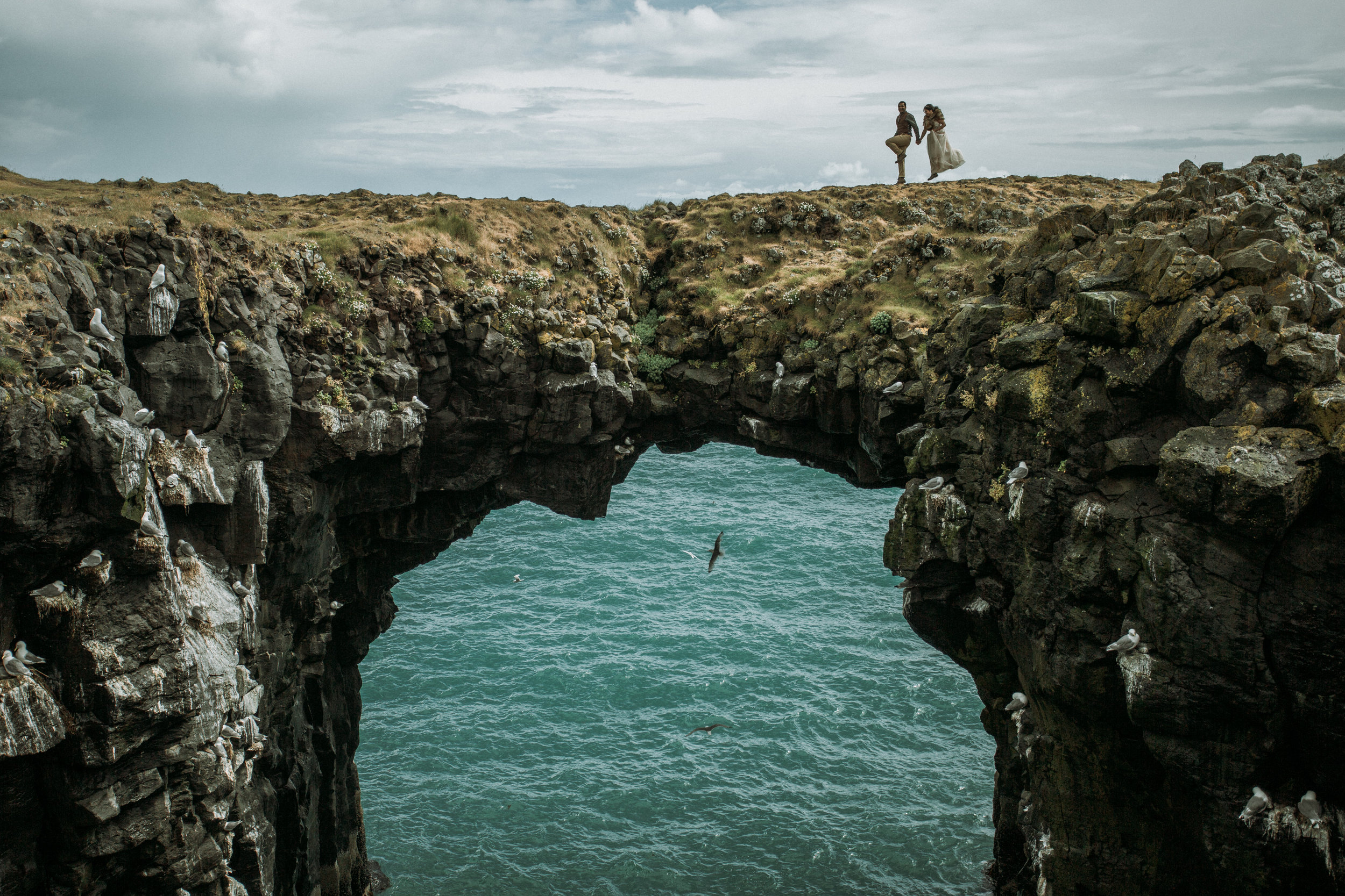 iceland sea cliff arch wedding photos