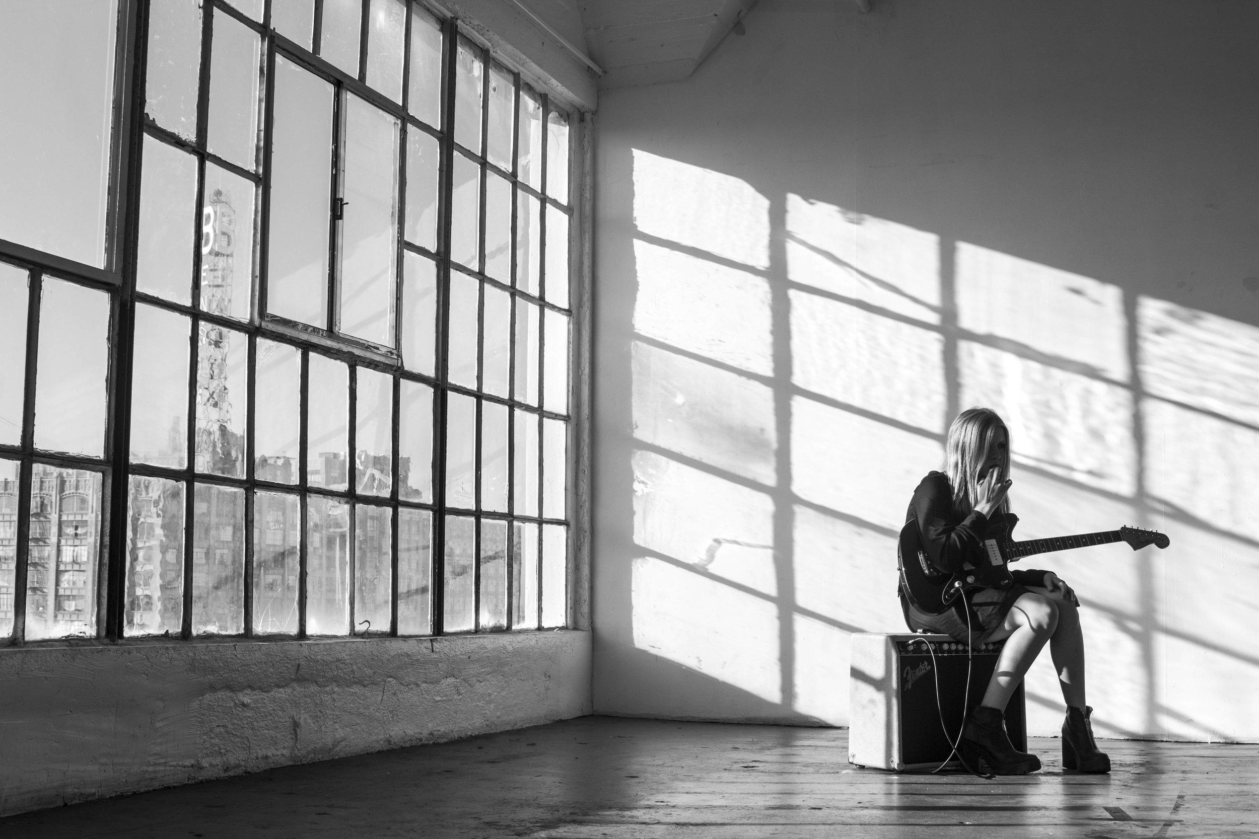 WRENN_bw_by window with guitar.jpg