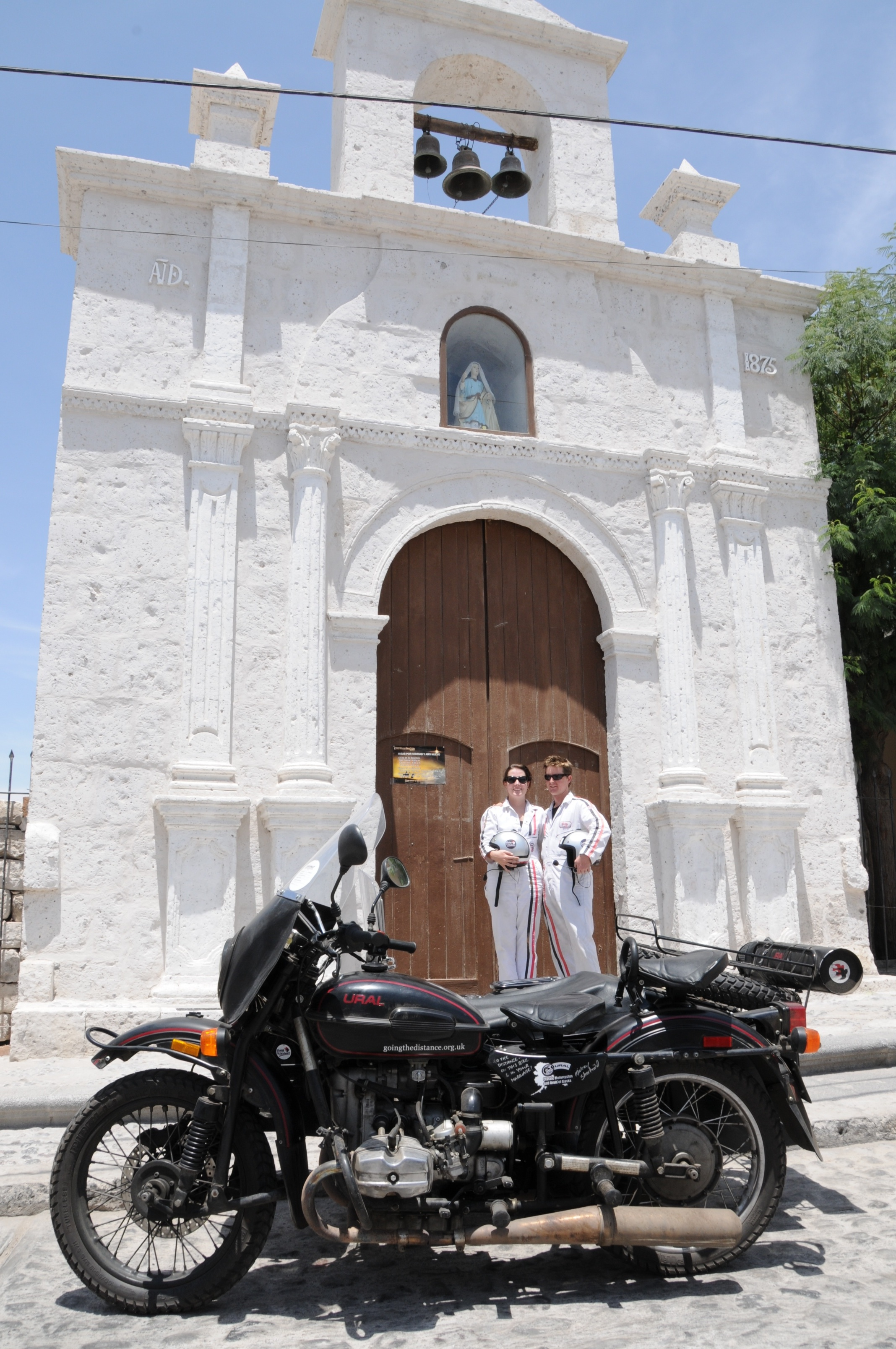 m&a standing in front of white church.jpg