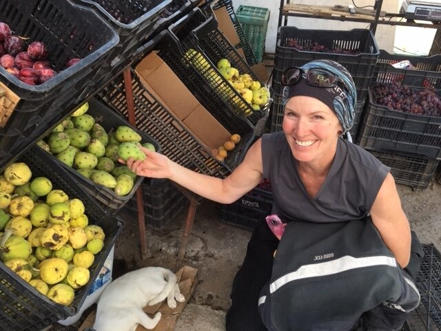 Elle picking fruit, roadside stand, Mexico.
