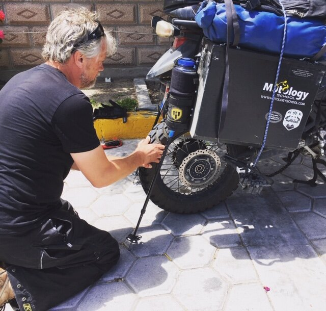 Jeremy removing rear wheel to fix flat, Mexico.