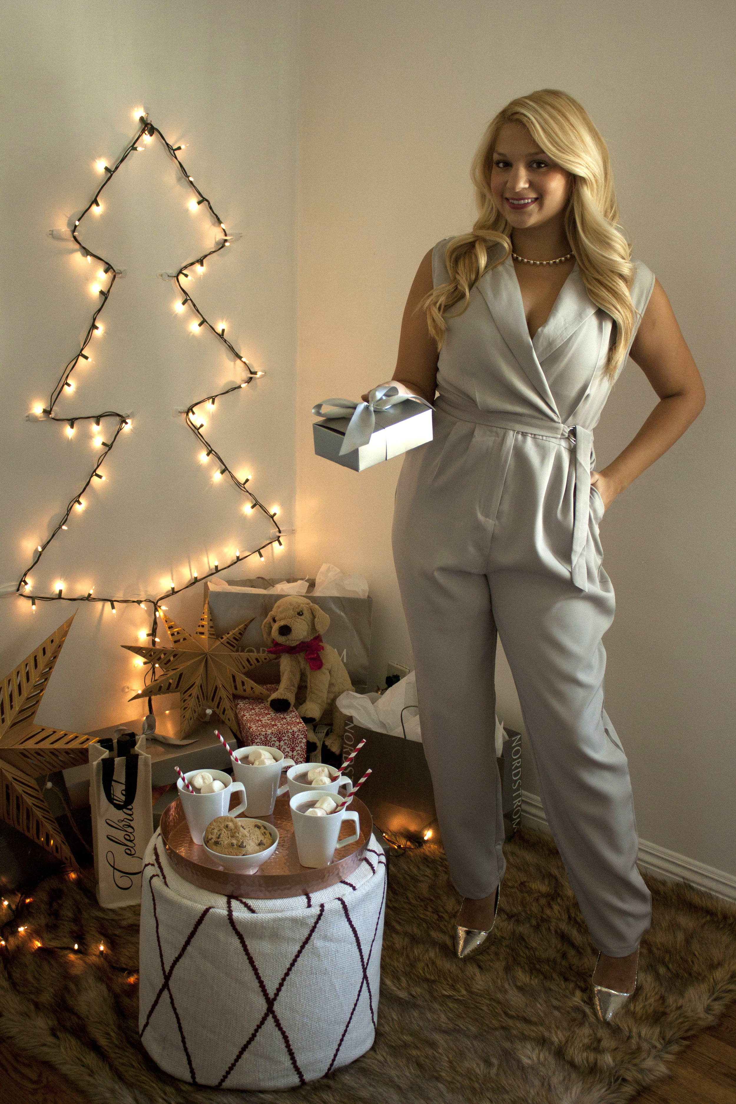 Cozy up with the family to open gifts in this comfy and classy jumpsuit.