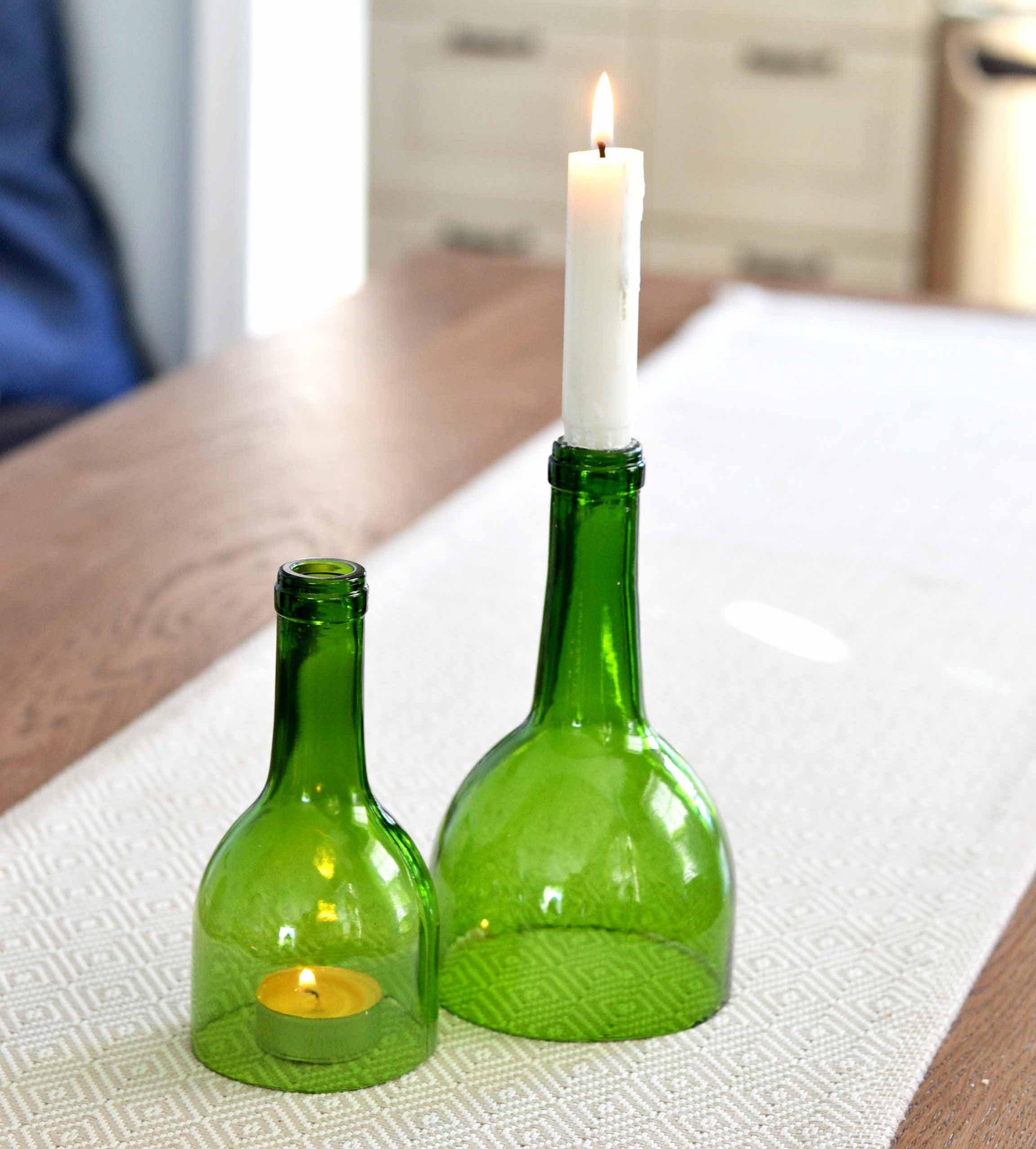 DIY #2 - Candle sticksThe second diy is also candle related and is an idea of what to do with the tops of your bottles. It could also be a great gift or just a cool way to dress up your dining table.Simply sand and clean off bottle tops and pop in some candles.
