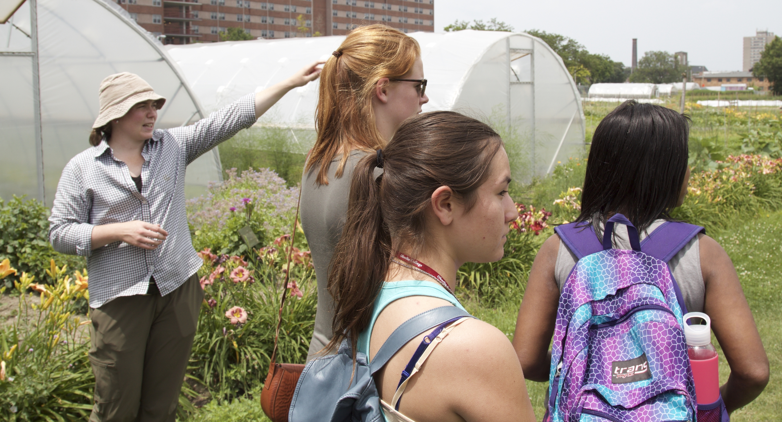 Students tour Ohio City Farm, the nation's largest contiguous urban farm, with Maggie Fitzpatrick,Director of Agricultural Empowerment, Refugee Response