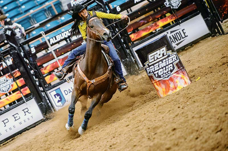 Navajo Times   Adron Gardner Kassidy Dennison rounds the final barrel during the 2016 ERA Premier Tour rodeo at Tingley Coliseum in Albuquerque Friday. Dennison finished with a time of 14.29 seconds.