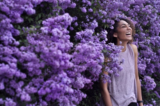 stock-photo-people-black-purple-happiness-spring-skin-flowers-woman-happy-97780e81-e209-4dad-b61e-0ab86dcef6c8.jpg