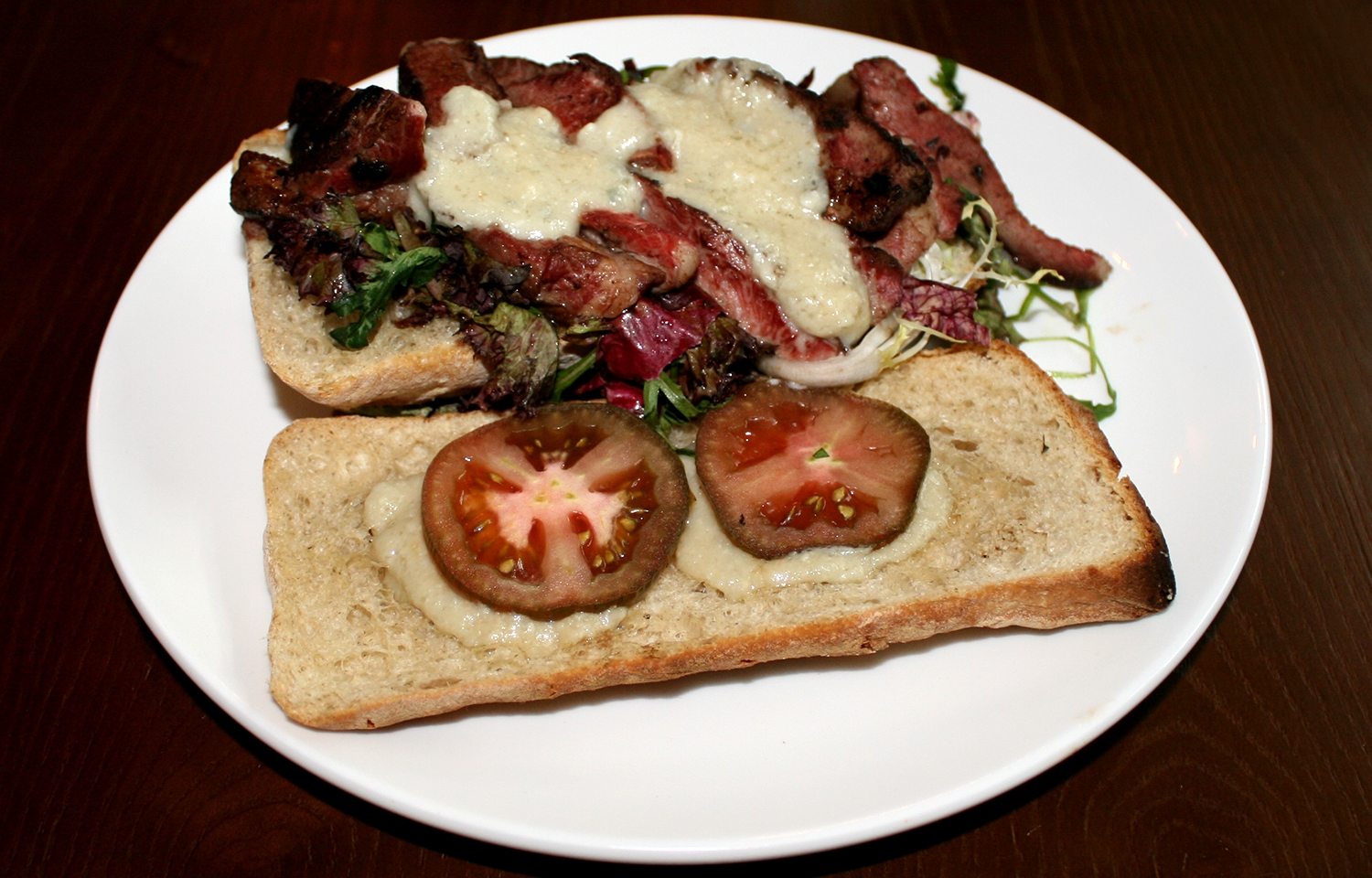 Ciabatta bread with smoked cheese, grilled beef and tomatoes