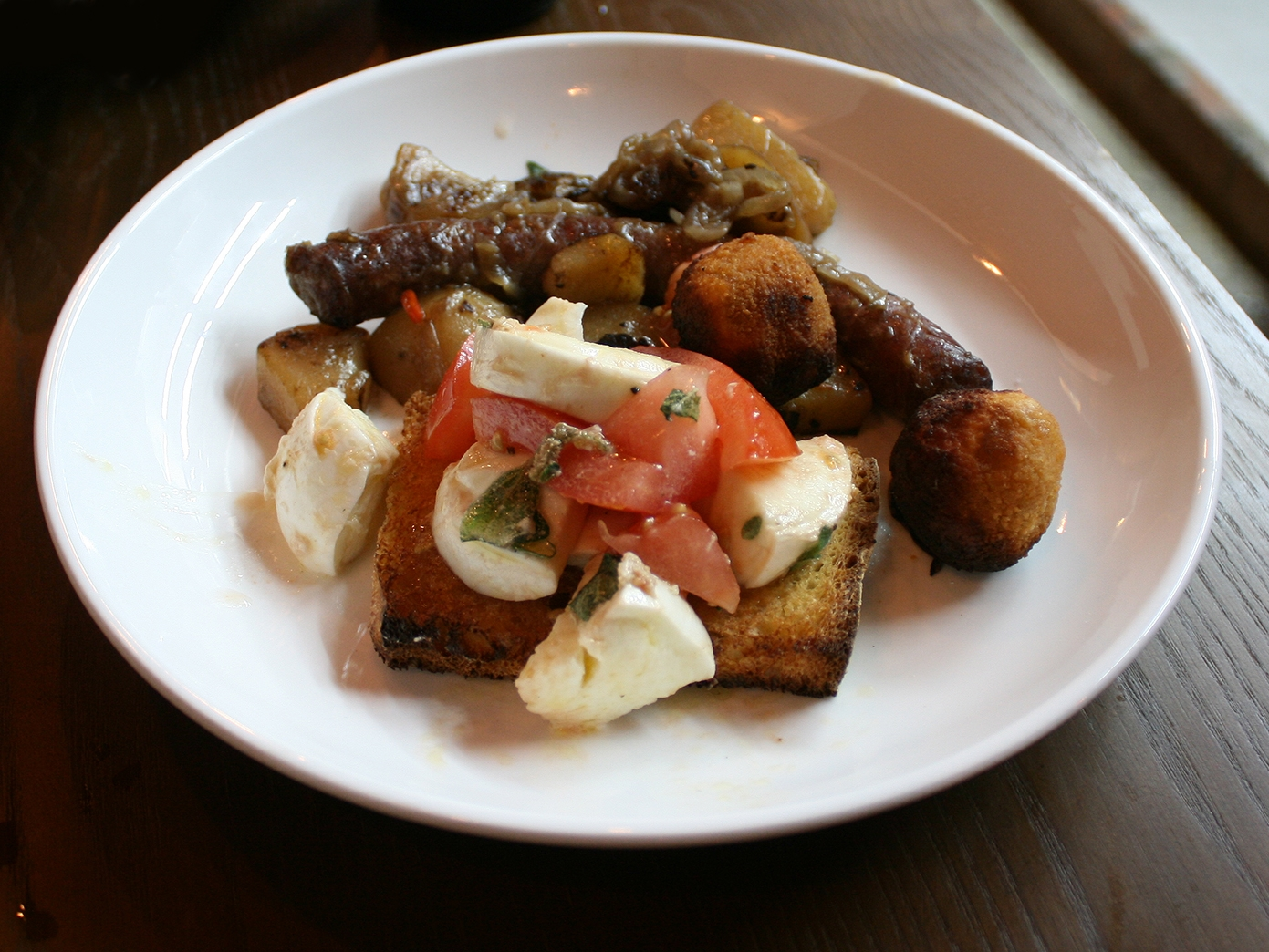 Italian sausage with buffalo mozzarella and tomatoes