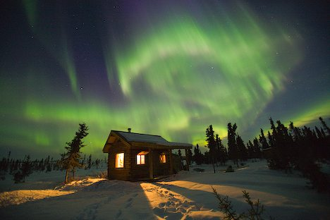 Picture of Aurora Borealis and warm log cabin