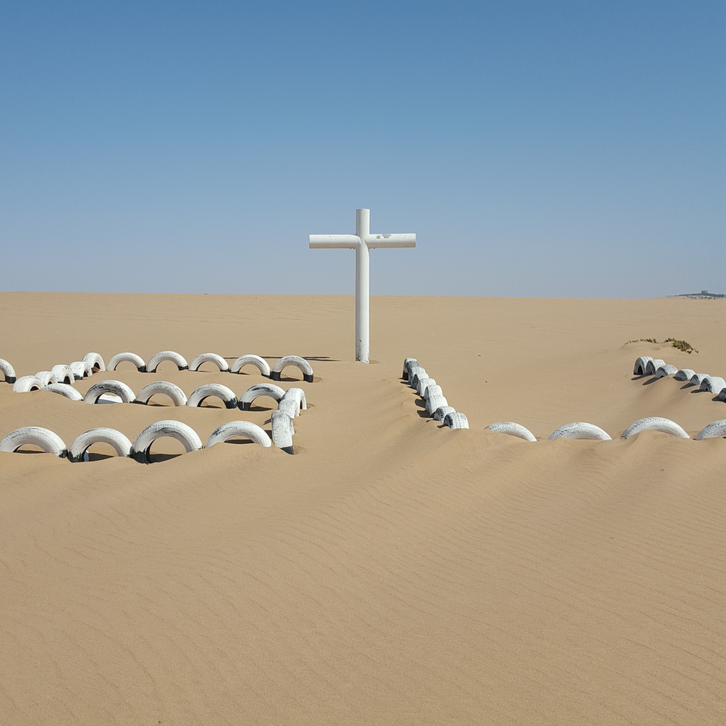 A lonely cross pitched in the center of the Namib Desert in Namibia, a place considered by many to be the first desert on Earth. (2015)