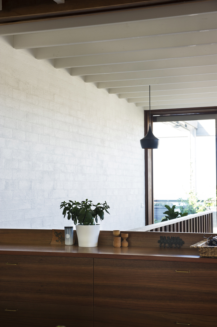 texture - bagged brickwork, spotted gum joinery & windows, exposed painted beams