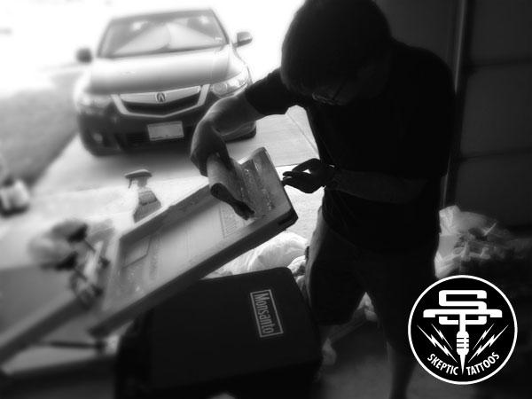 Arlo's friend, Nam, applying the Monsanto silkscreen.
