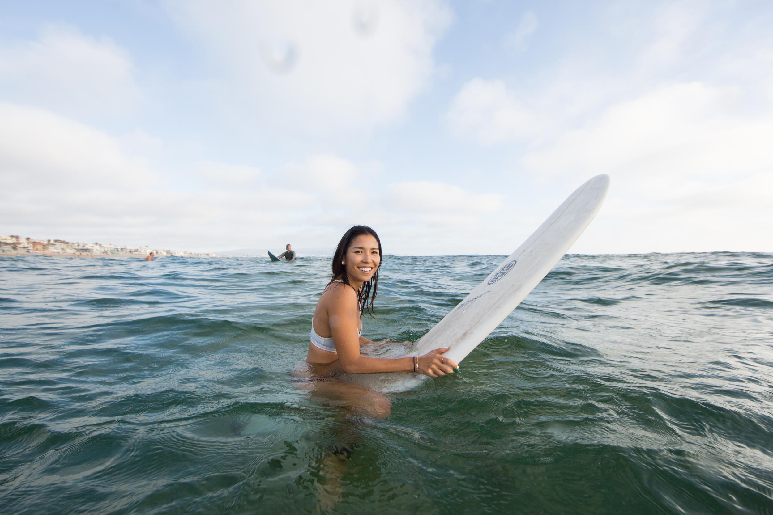 Surfing the waves at the Manhattan Beach Pier