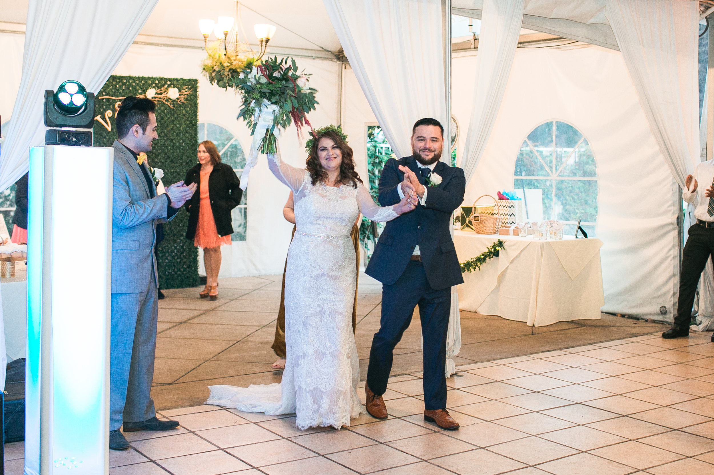 Welcoming the bride and groom to the reception!