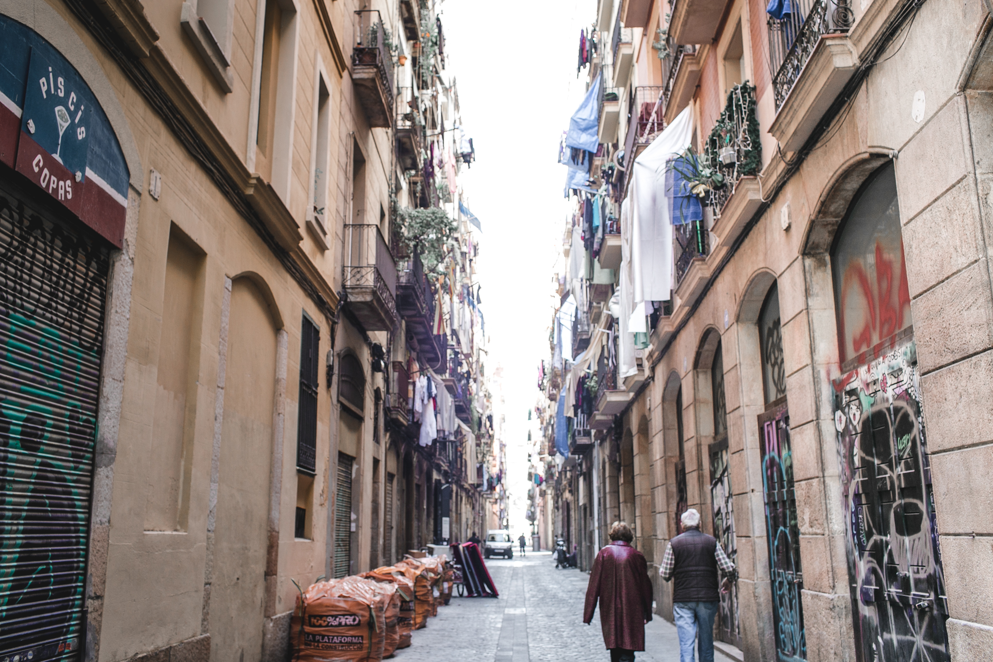 The streets of Raval were doused with graffiti. Laundry hung from every balcony. And typically, these alleys would be full of skateboarders and young hip artists. One of the reasons why we loved this area was because of the lack of tourists.