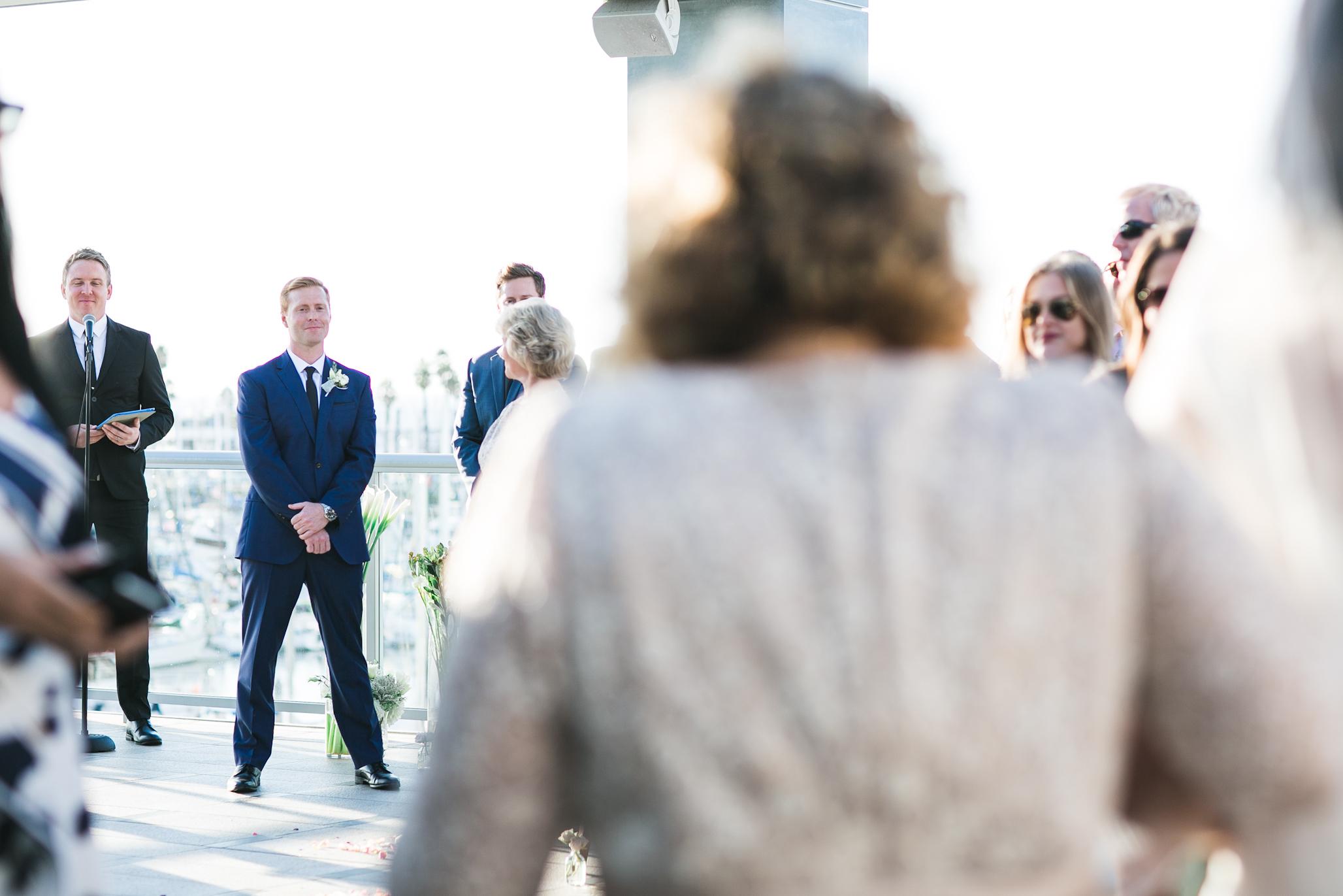Seeing his bride walk down the aisle.