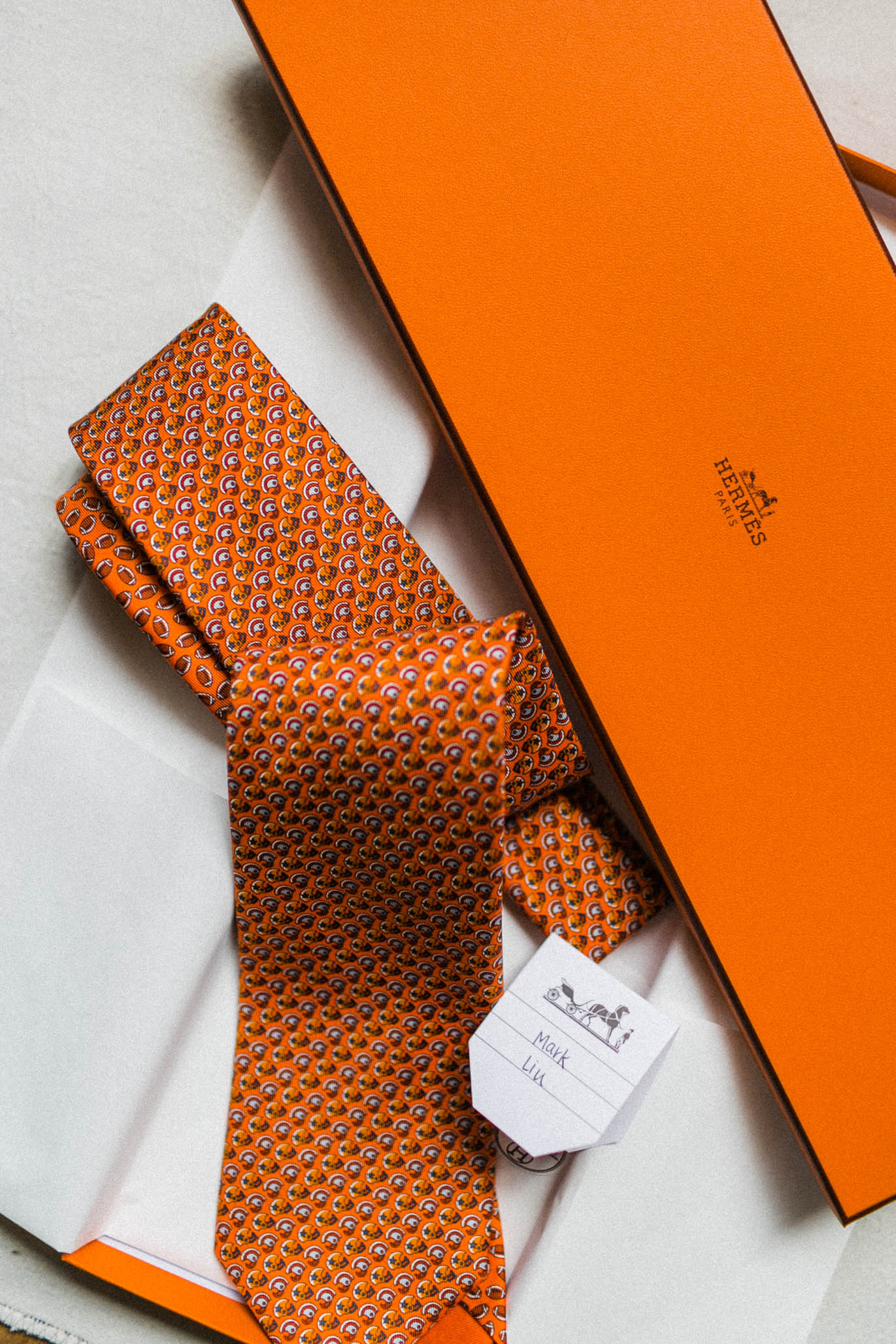 Jeff gifted his groomsmen with these personalized  Hermes  ties.