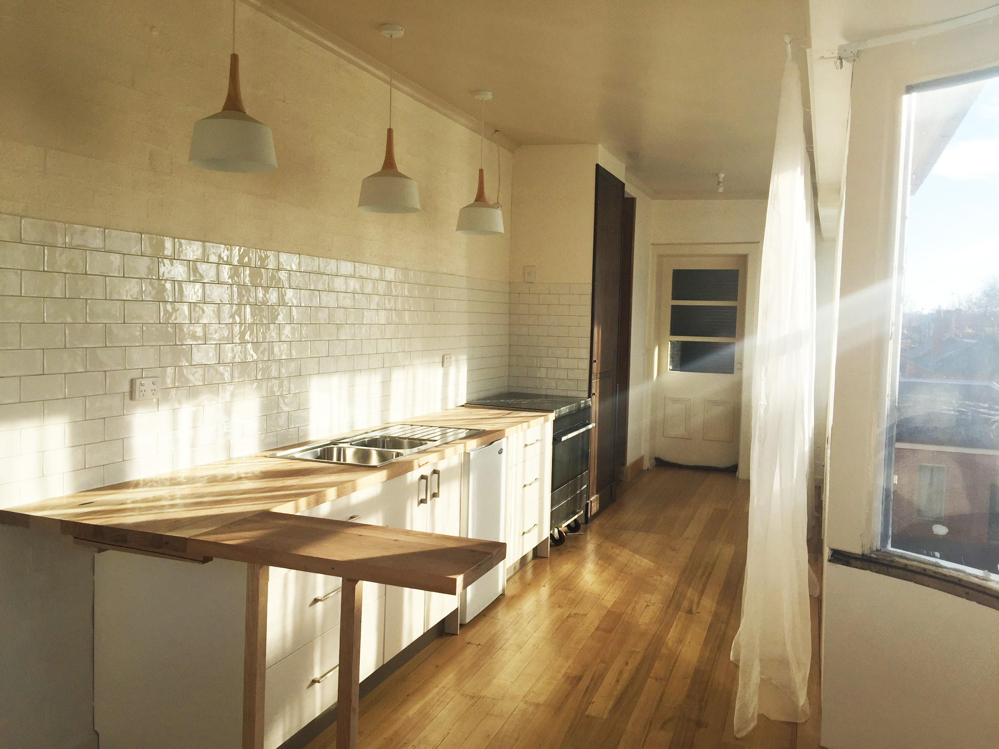 Kitchen renovation with view and natural light_Here Studio.jpg
