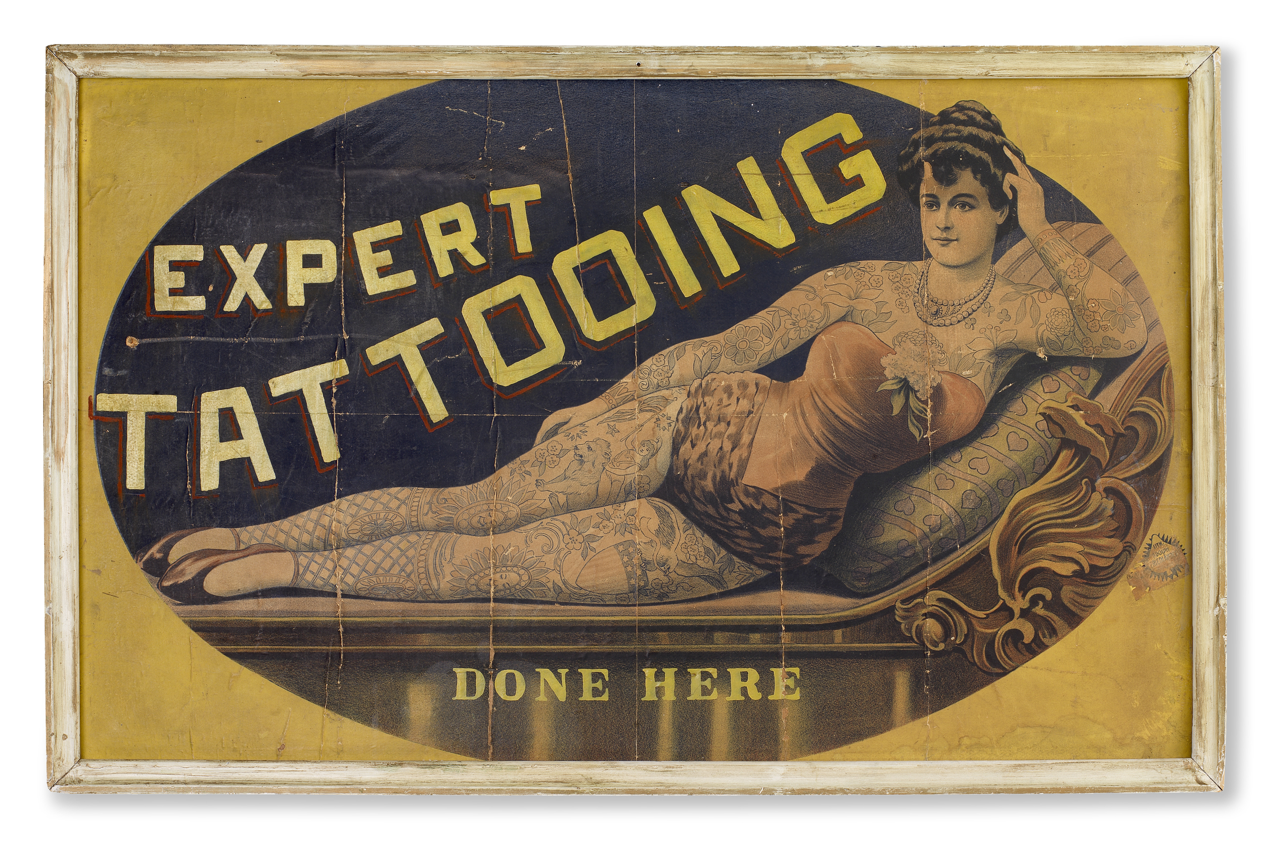 American turn of the Century tattoo parlour poster of a classically posed reclining painted lady. Pop artists such as Peter Blake and Larry Rivers referenced this kind of authentic Americana. In as-found condition, measuring 96cm x 60cm.