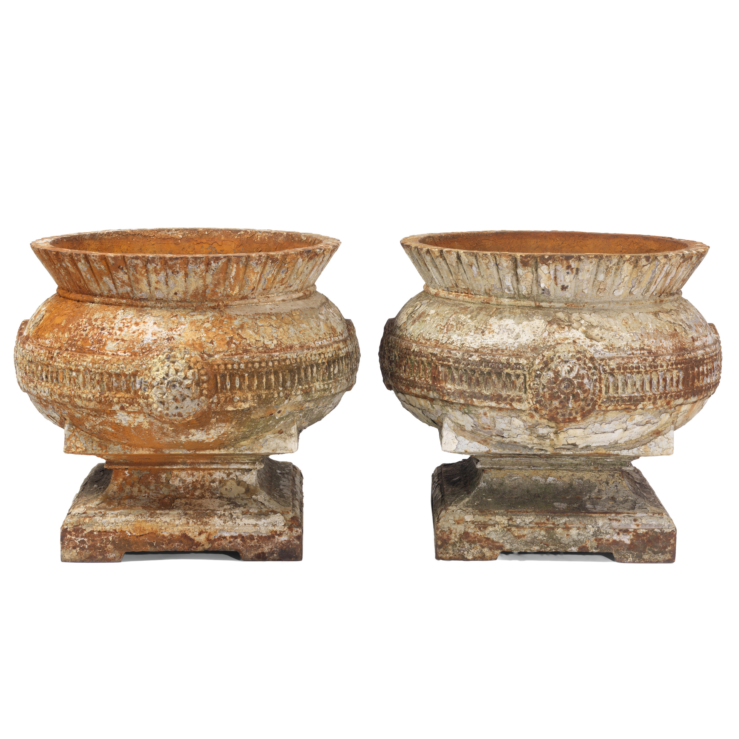 A large pair of Aesthetic Period planters. Squat form leading to fluted, flared rim, with stylised medallions on geometric banding. Original condition.  In the manner of Dr Christopher Dresser. 1880  Highly unusual.  Height 48cm, diameter 54cm.  AVAILABLE.