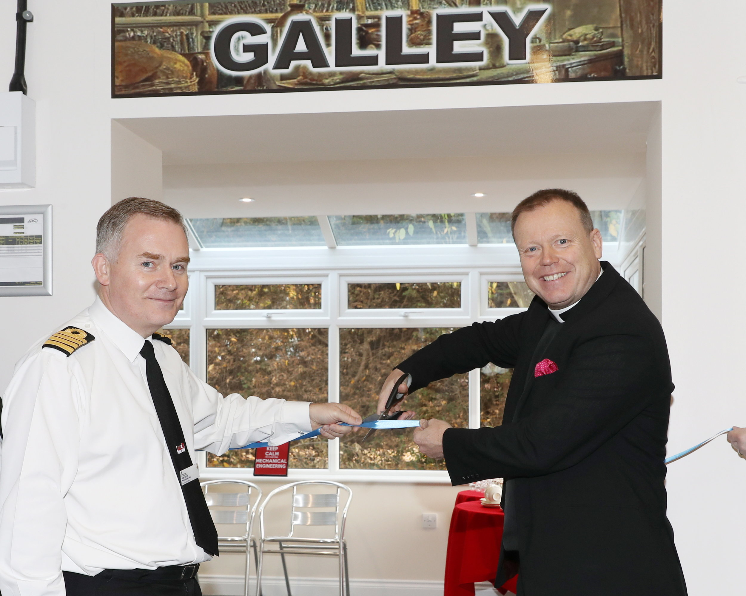 Captain Peter Towell, the Commanding Officer of HMS Sultan, assists Royal Navy Chaplain of the Fleet, The Venerable Ian Wheatley QHC BTh in opening the new Galley at The Haven.
