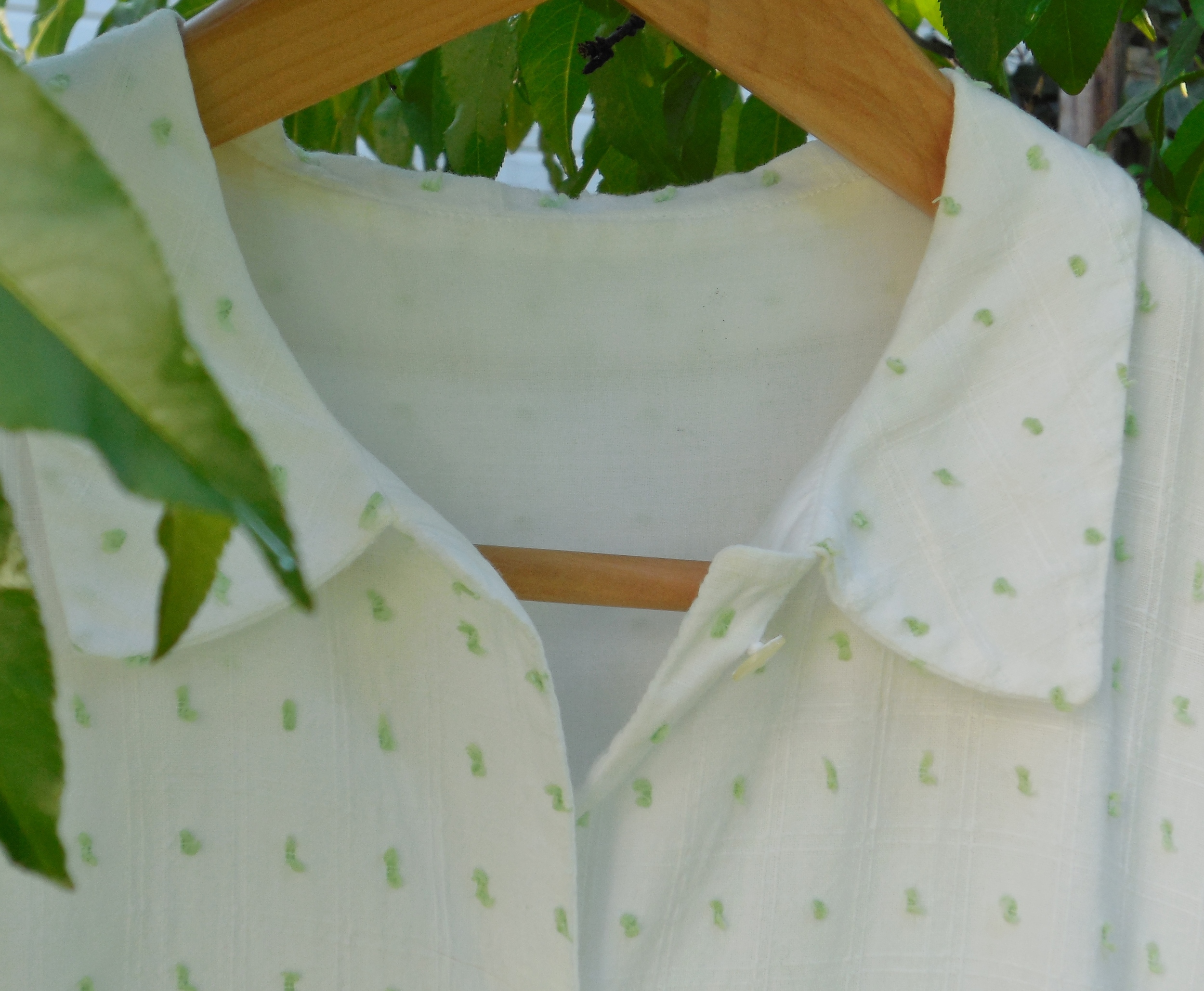 Detail from Anikka Becker  shirtwaist dress in white cotton dimity with mint dot