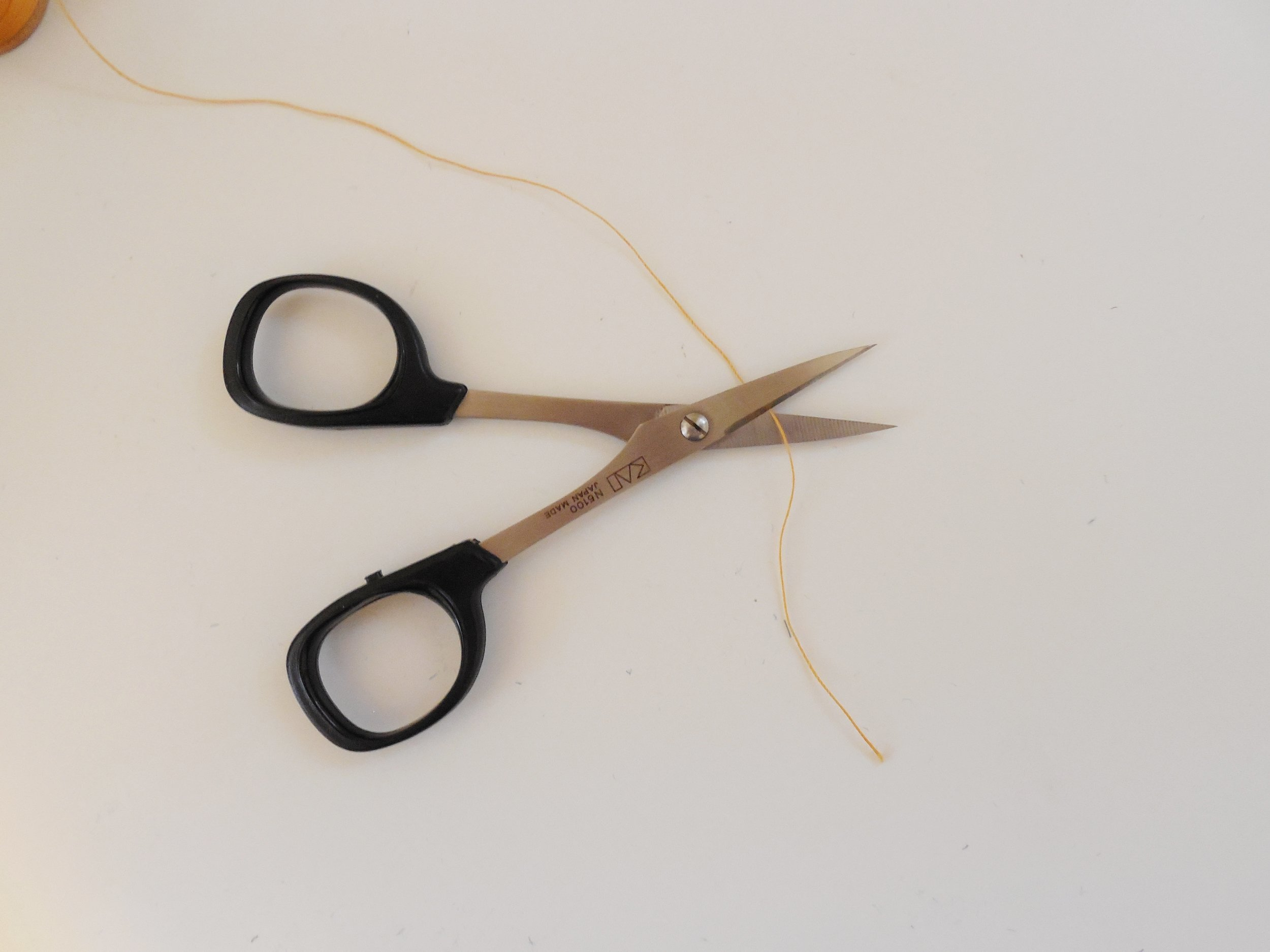 Embroidery scissors - Tiny and fierce, these delicate looking Kai embroidery scissors are used to snip thread. They are so precise that they can cut stray threads right at the surface of the garment without making a nick.