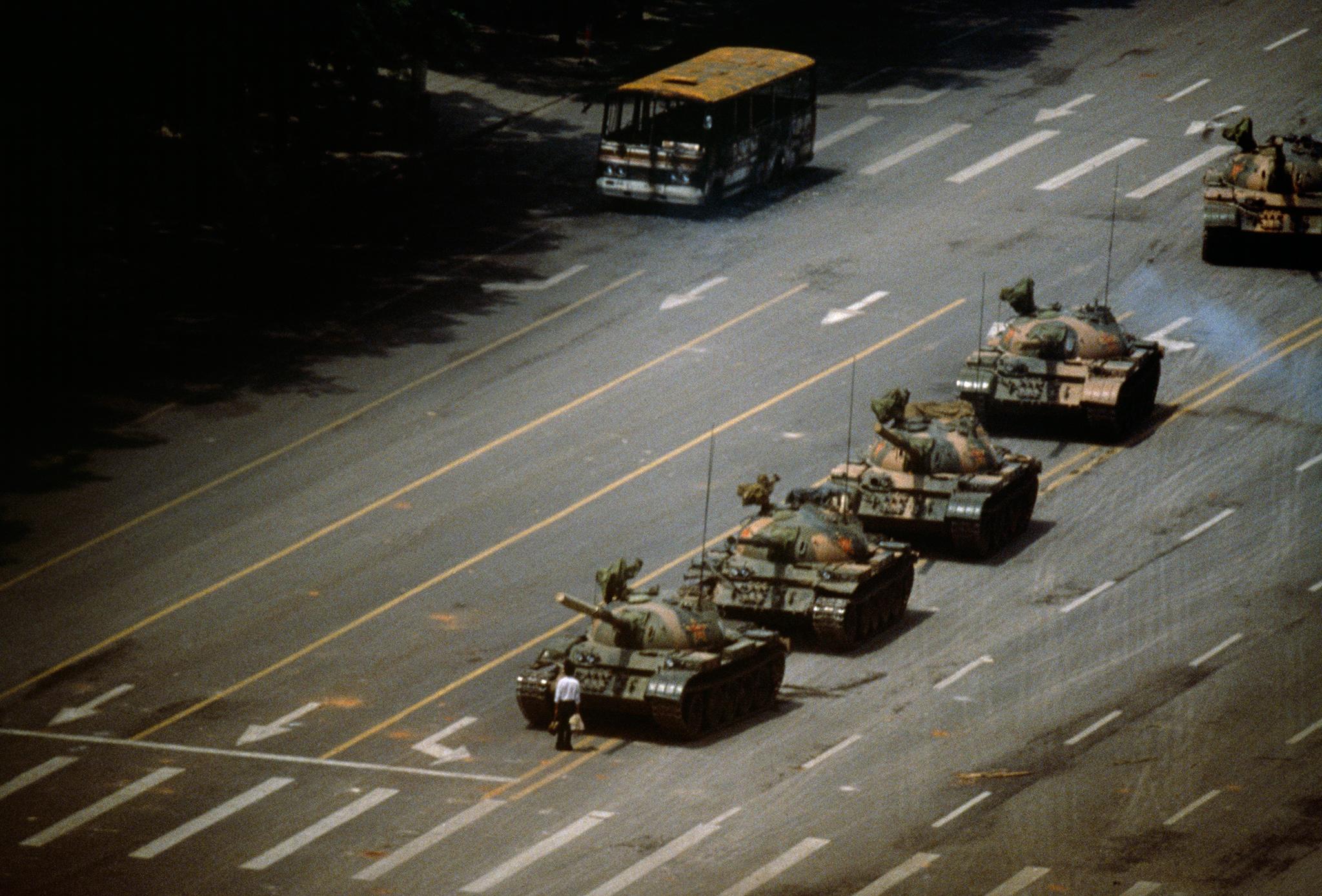 """""""Tank Man"""" 1989 Jeff Widener (Associated Press)  An unknown protester stands along in front of a parade of tanks in Tiananmen Square in Beijing, China, during the protests against the regime and subsequent violent government crackdown."""