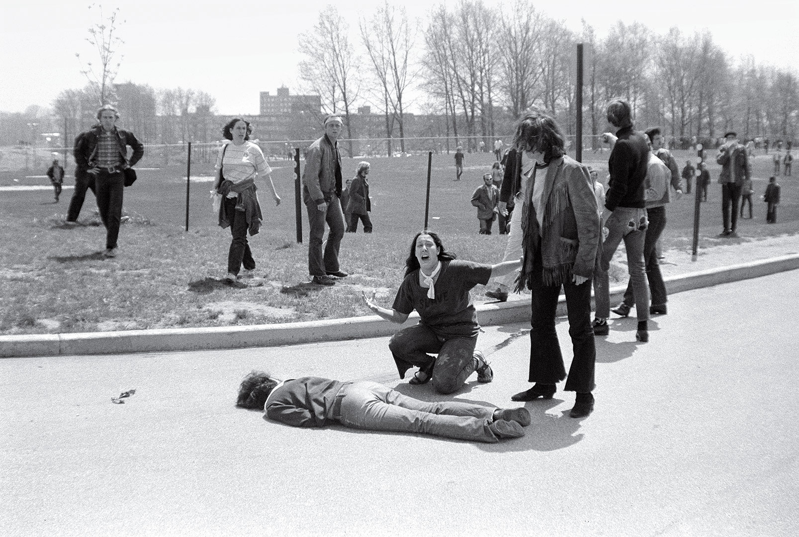 """""""Kent State Shooting"""" 1970 John Paul Filo  """"The shooting at Kent State University in Ohio lasted 13 seconds. When it was over, four students were dead, nine were wounded, and the innocence of a generation was shattered. The demonstrators were part of a national wave of student discontent spurred by the new presence of U.S. troops in Cambodia. At the Kent State Commons, protesters assumed that the National Guard troops that had been called to contain the crowds were firing blanks. But when the shooting stopped and students lay dead, it seemed that the war in Southeast Asia had come home. John Filo, a student and part-time news photographer, distilled that feeling into a single image when he captured Mary Ann Vecchio crying out and kneeling over a fatally wounded Jeffrey Miller. Filo's photograph was put out on the AP wire and printed on the front page of the New York Times. It went on to win the Pulitzer Prize and has since become the visual symbol of a hopeful nation's lost youth. As Neil Young wrote in the song """"Ohio,"""" inspired by a LIFE story featuring Filo's images, """"Tin soldiers and Nixon coming/ We're finally on our own/ This summer I hear the drumming/ Four dead in Ohio."""" -- TIME MAGAZINE"""
