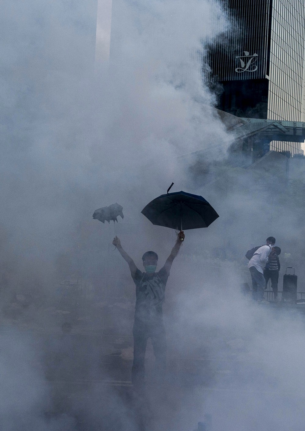 Hong Kong Protestor 2014 Xaume Olleros (AFP/Getty Images)  A pro-democracy demonstrator holds an umbrella after police fired tear gas towards protesters near the Hong Kong government headquarters, in a dramatic escalation of the Umbrella Revolution protests.