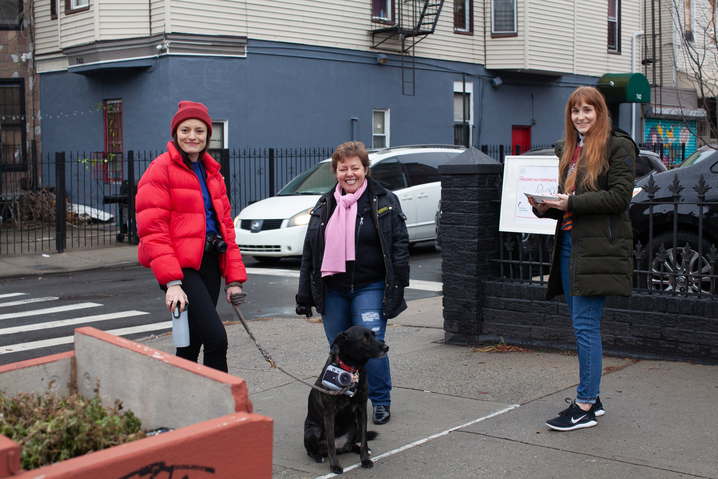 Iris Ebert, Mariana Spirindon, Gloria Cook and Leila spreading a little holiday cheer outside BKC.