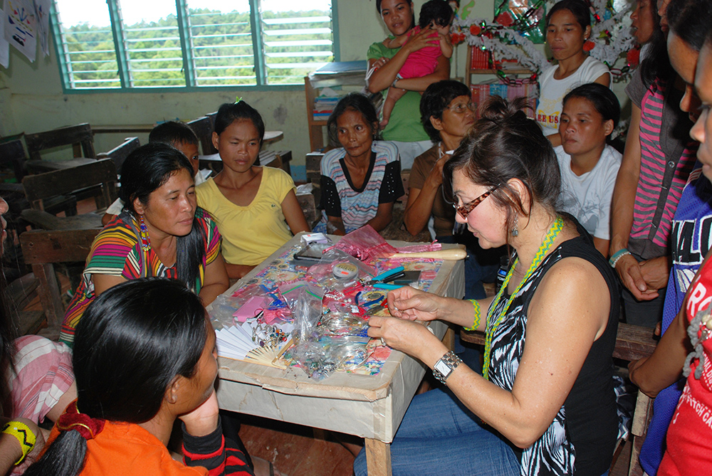 Diane teaching jewelry making.jpg