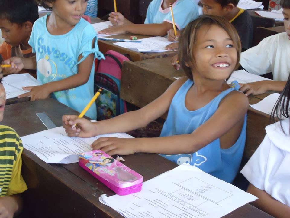 Fear turned to hope smiling through on the face of Rosalinda, now a schoolgirl who can write her own name!