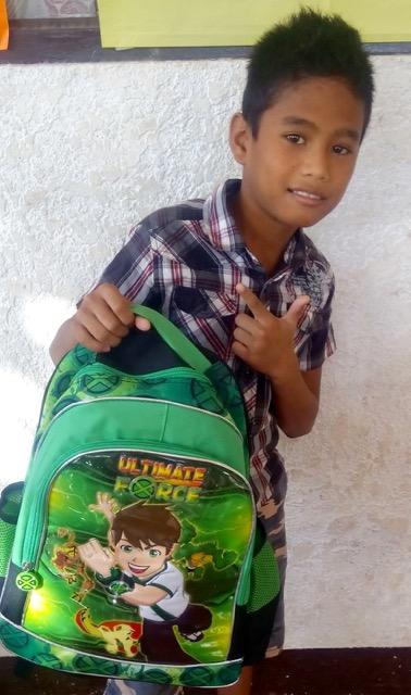 Junior with his book bag May 2016 (2).jpg