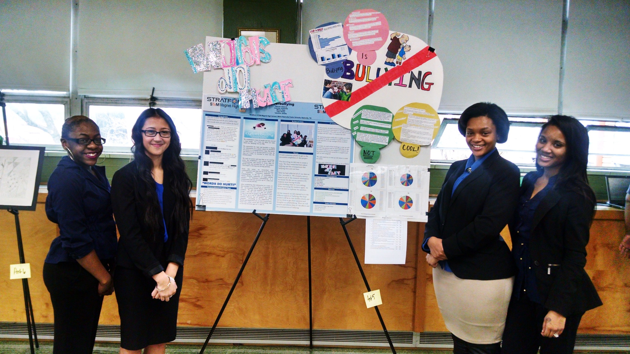 Four junior Stratford STEM students proudly display their project on cyber-bullying in schools. Great work ladies!