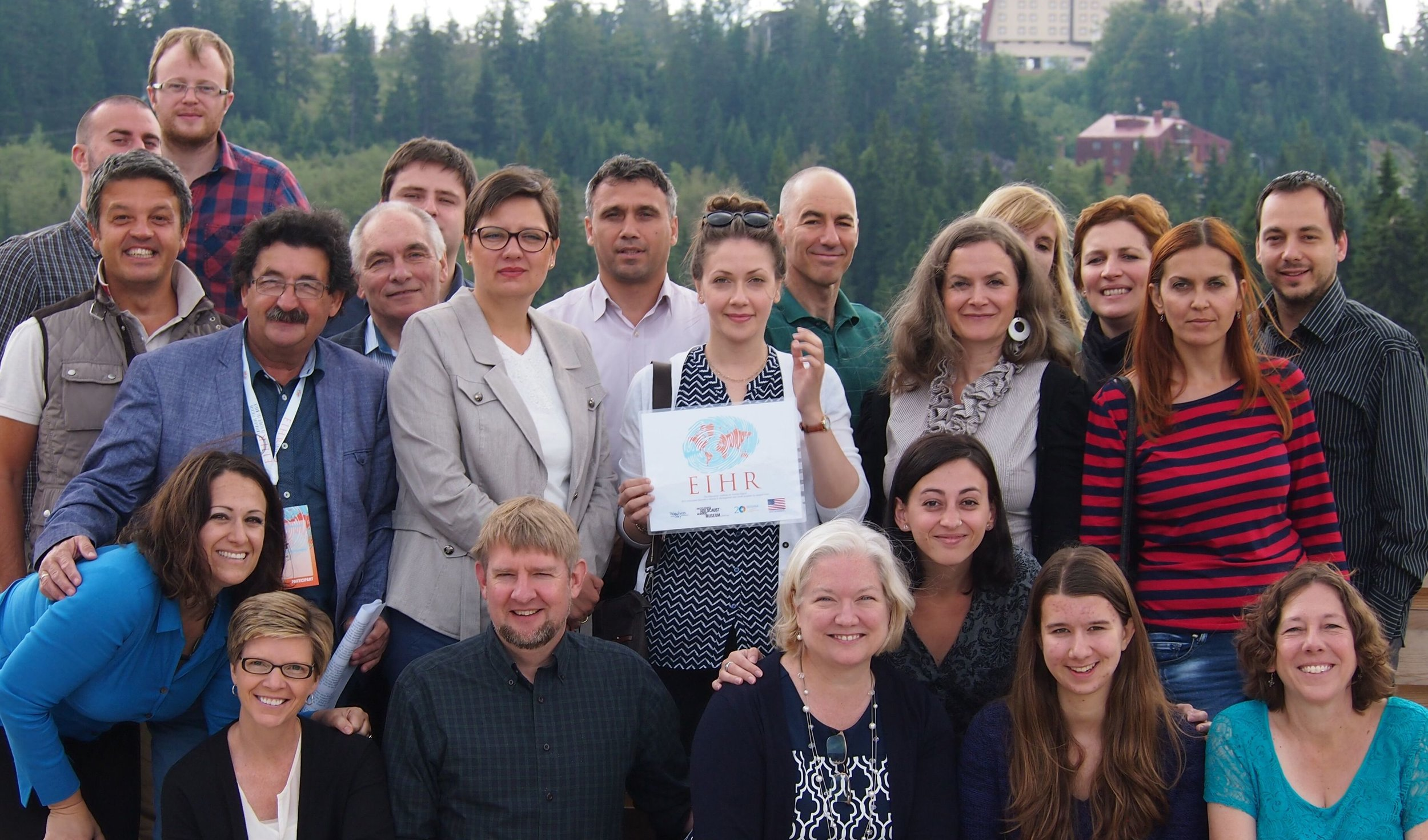 Alma, center with sign, at the EIHR Education Summit in Jahorina, 2015