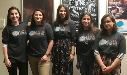 Student interns welcome participants to the film screening