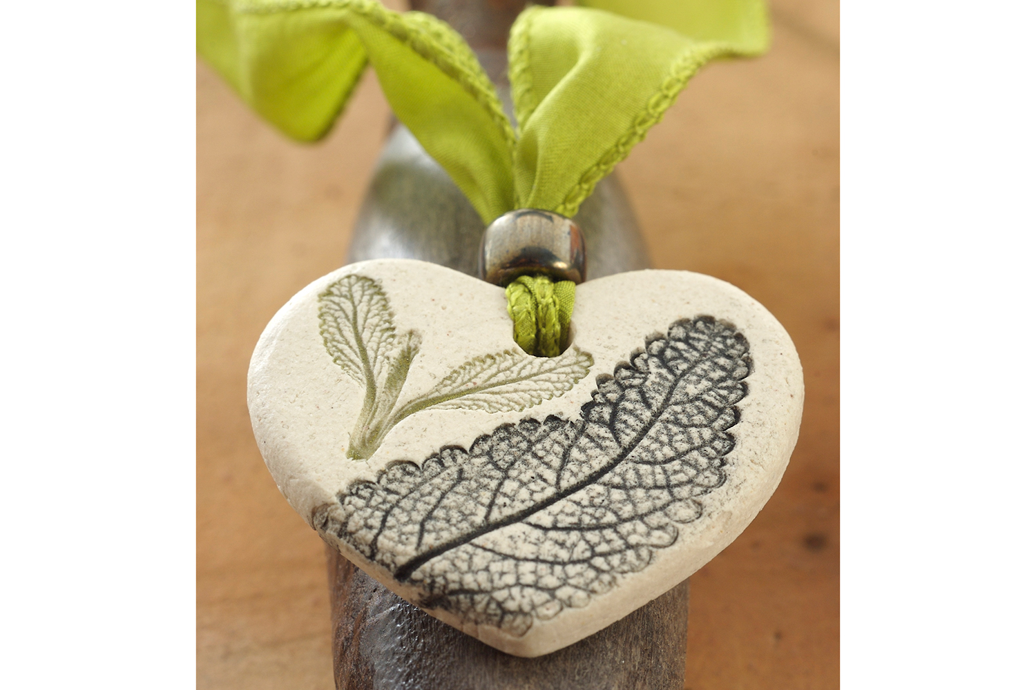 green-ribbon-and-botanical-heart-pendant.jpg