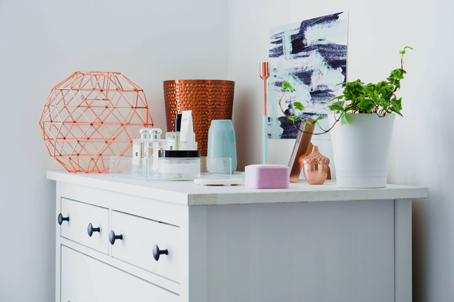 A blue, mint and copper-themed bedroom makeover