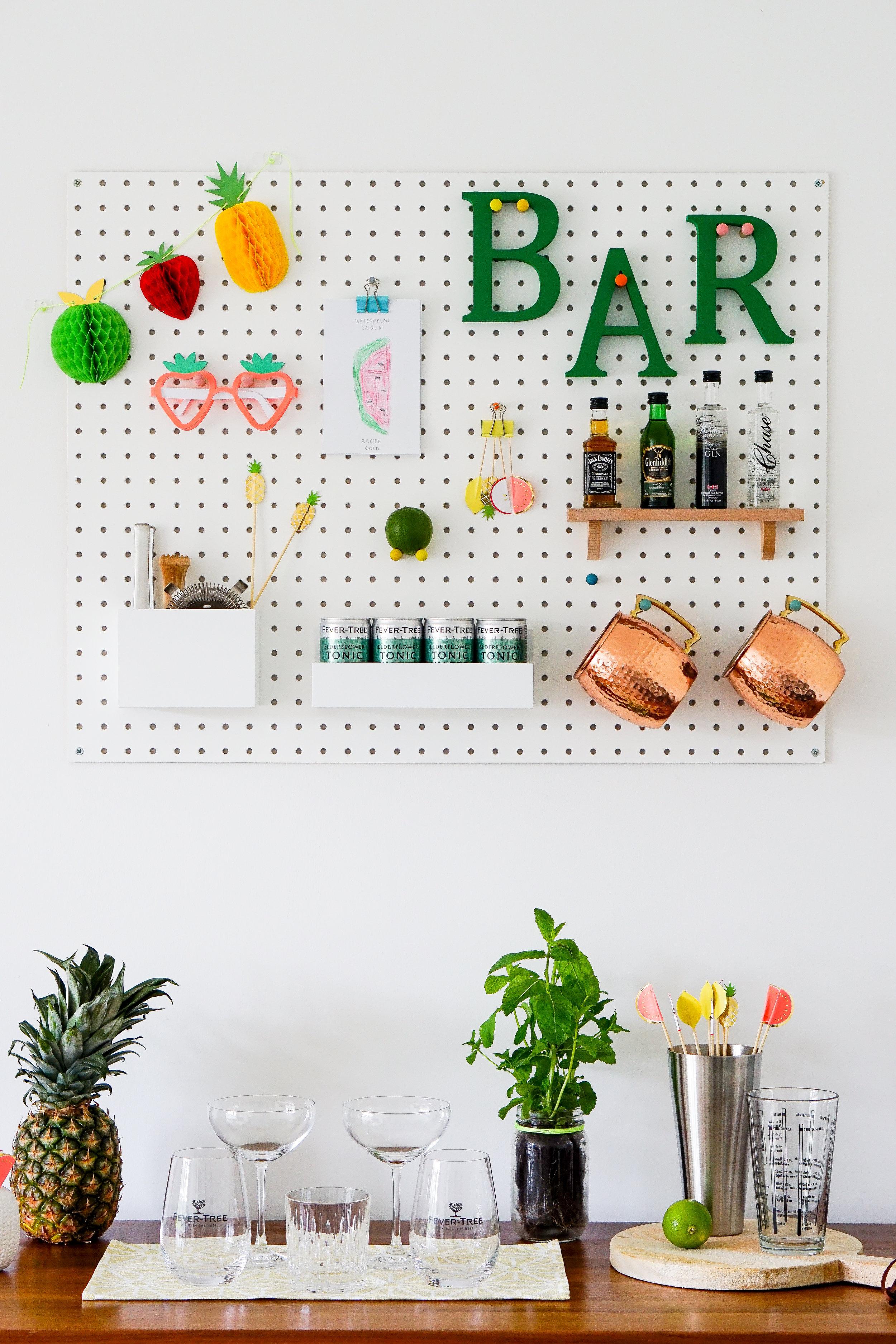 A totally tropical pegboard mini bar