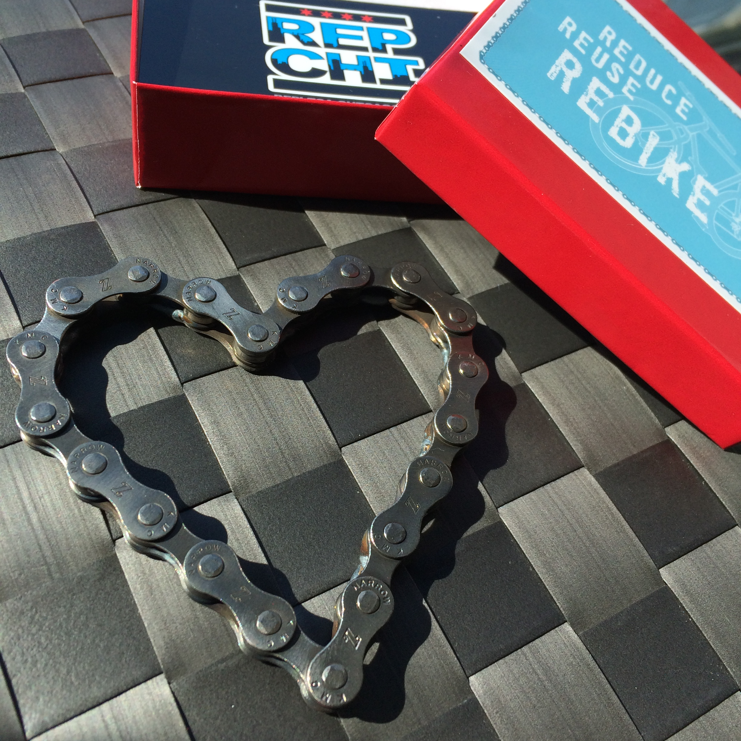 Heart shaped bike chain.  Paperweight, desk tchotchke, token of friendship.  It's a great thing, this recycled heart.