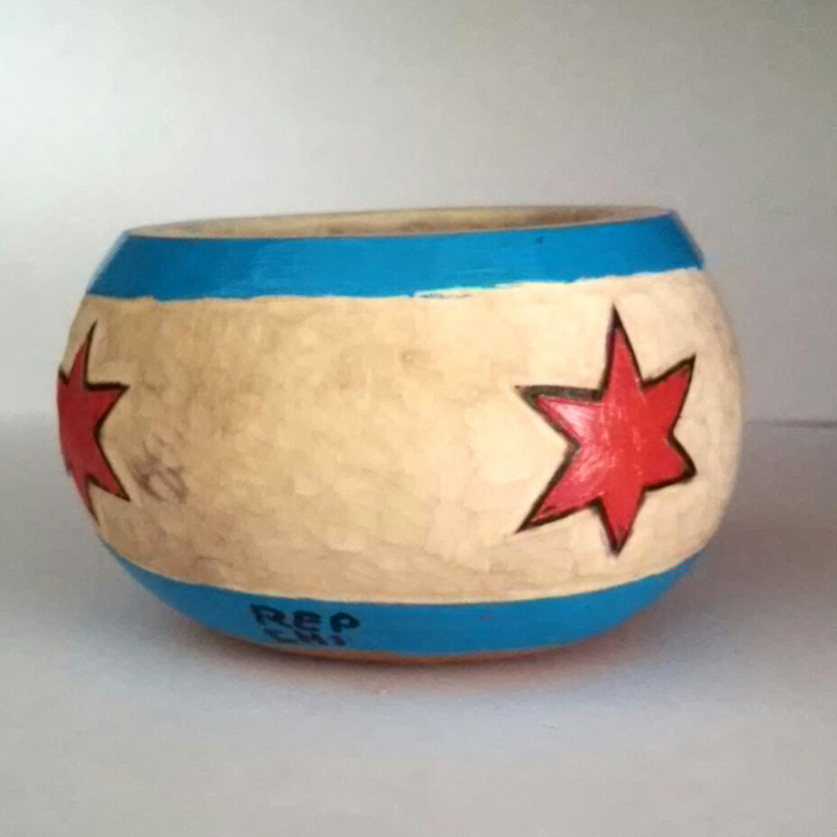 These fantastic Chicago Flag hand painted, hand-carved and pyrographed gourds that will be filled with soy candle wax.