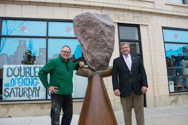 "PHOTO via DNAinfo.  Caption: ""Pandora's Shepard"" by Terrence Karpowicz, r., was installed in Jefferson Park Monday. State Rep. Robert Martwick helped sponsor its installation."